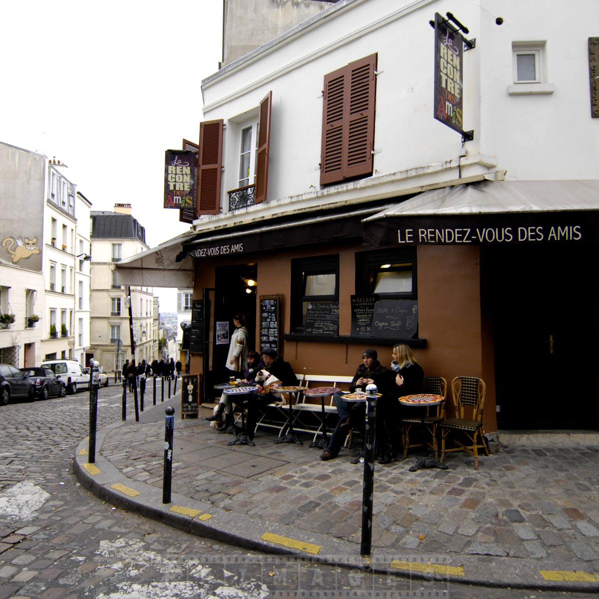 Couple enjoy coffee at a cute small restaurant in Montmarte