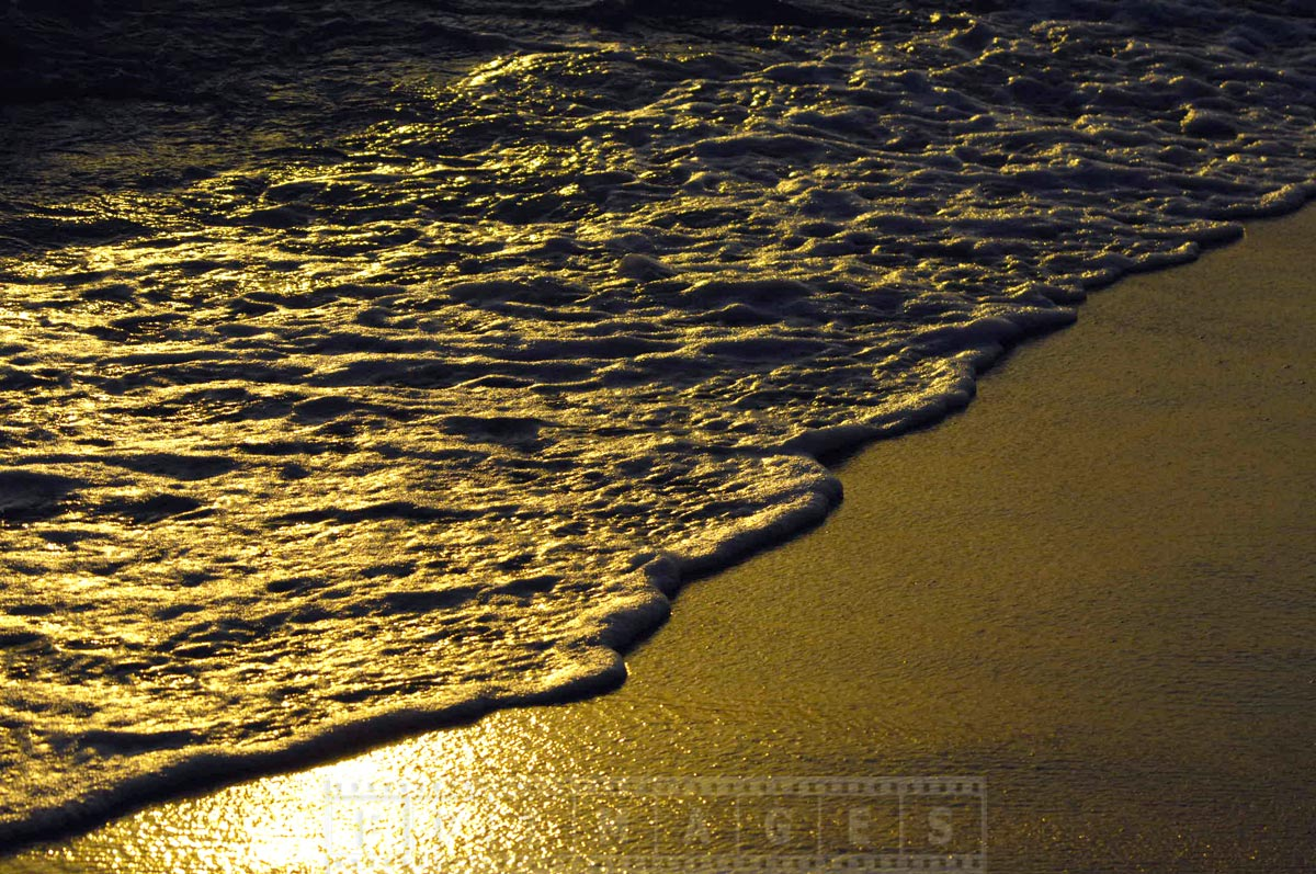 Romantic walk along the unspoiled beach at sunset