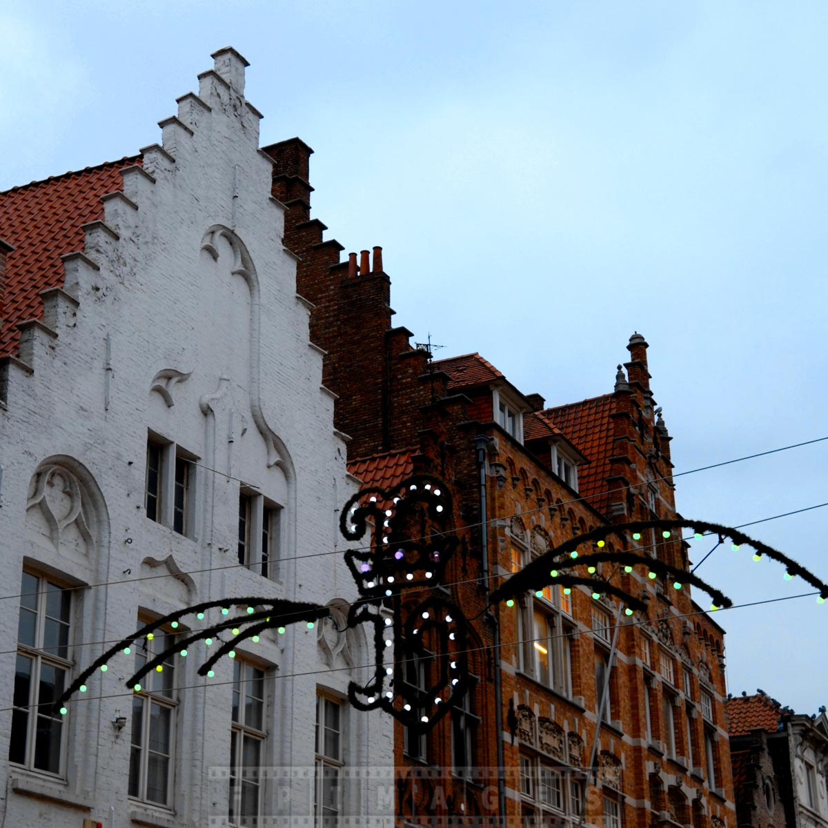Letter B for Bruges and typical medieval roofs of old European town