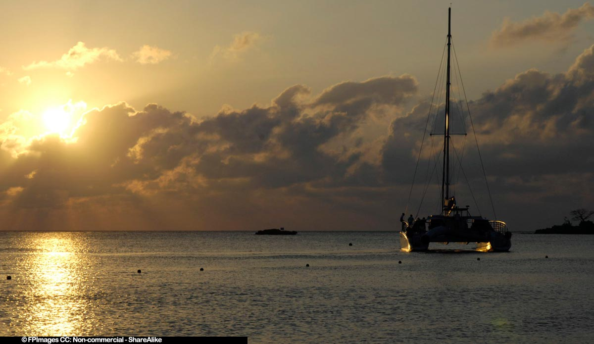 Romantic catamaran cruise during amazing tropical sunset on Bloody Bay