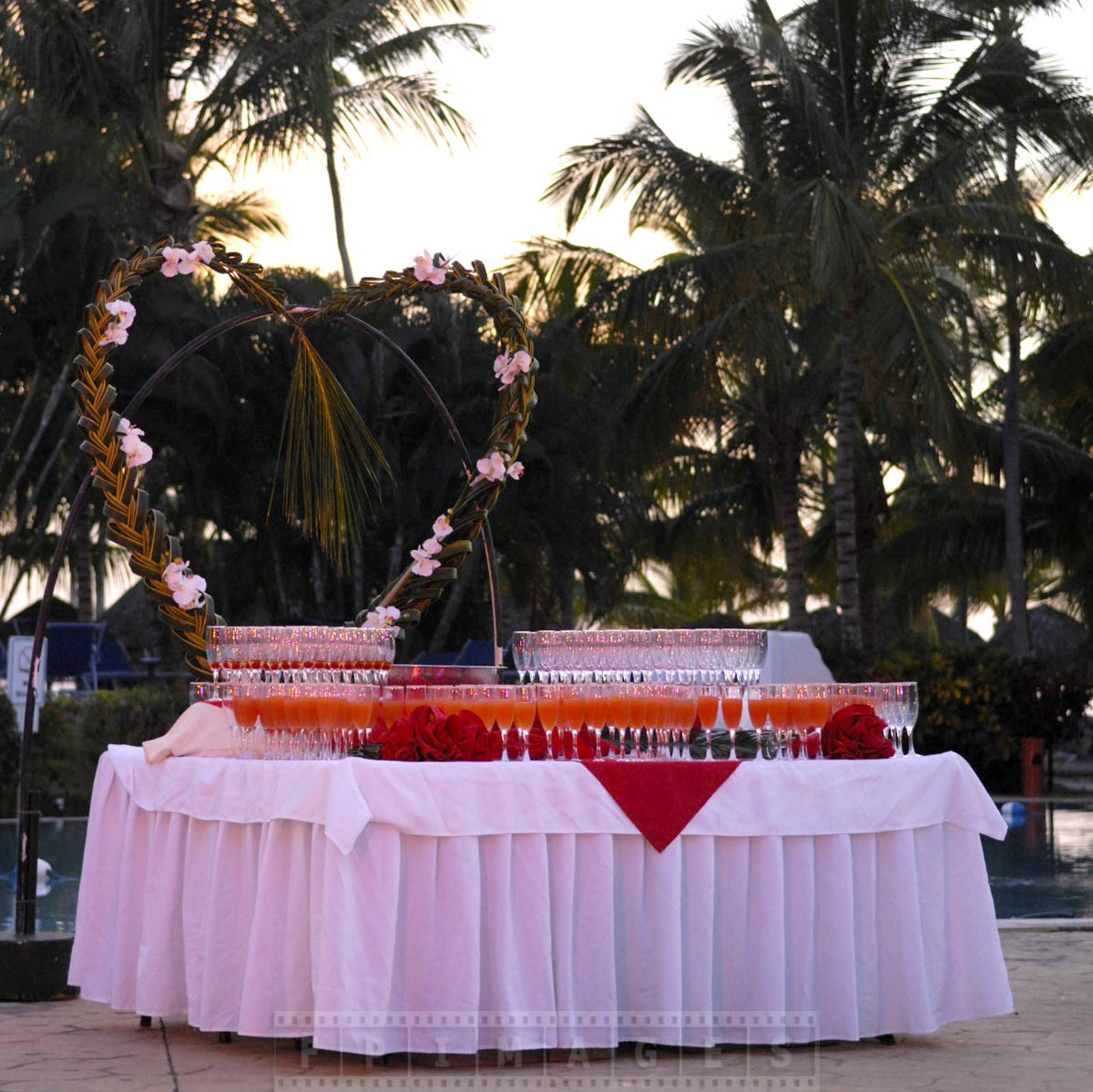 Champagne and drinks table decorated with a heart symbol