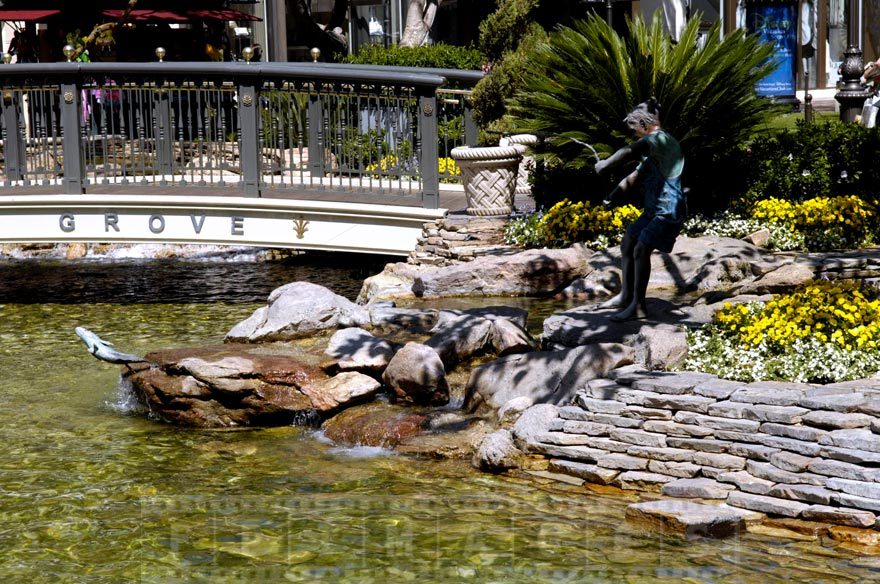 Boy fishing - statue near the pond at the Grove