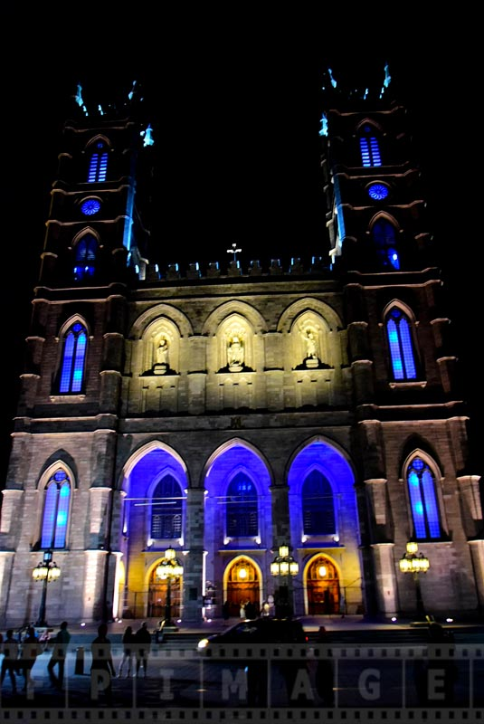 Facade of Basilica with blue light at night