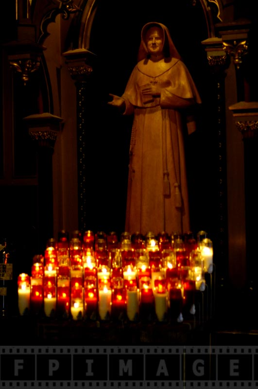 Statue of a saint with candles
