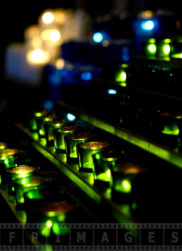 Green candles burning in the church