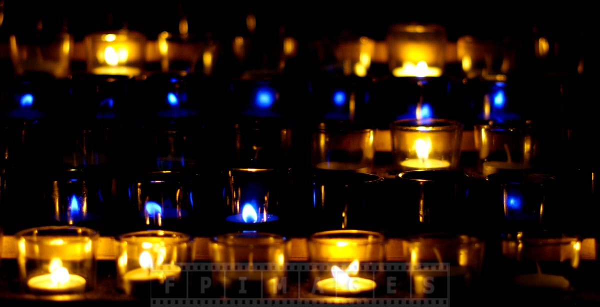 Blue and golden candles at Notre-Dame Basilica
