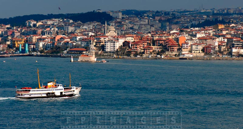 Istanbul ferry and Maiden Tower in Bosphorus