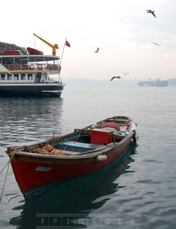 Fishing boat, ferry and a container-ship at Bosporus
