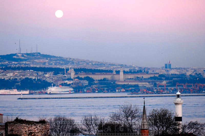 Full moon over Bosphorus and Istanbul lighthouse