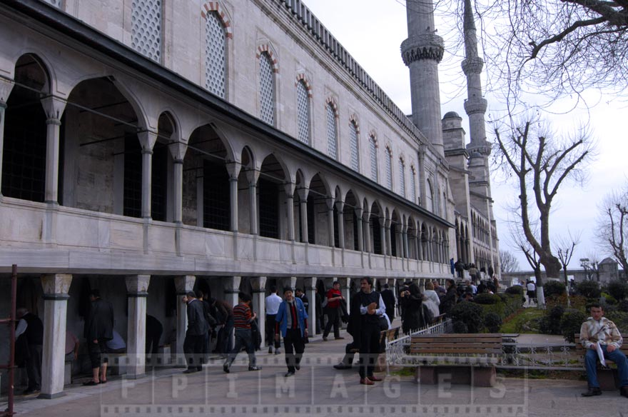 People getting for prayer at the mosque (ablution)