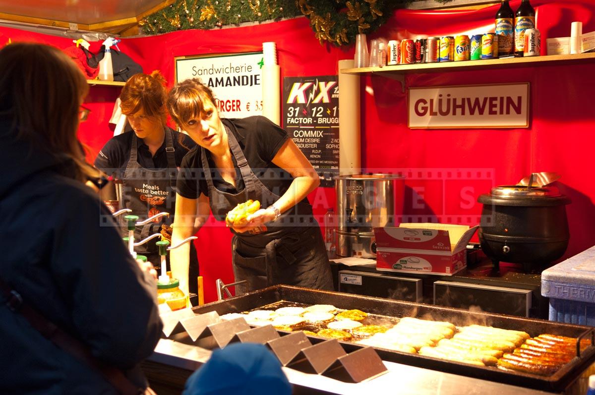 women making Belgian sausage sandwiches