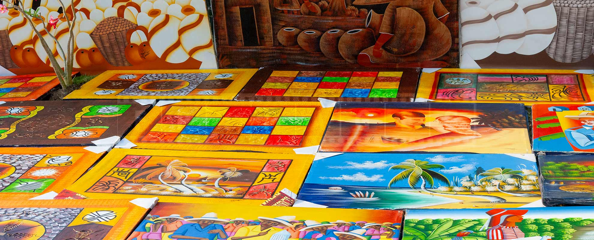 bright and colorful paintings at Dominican beach market