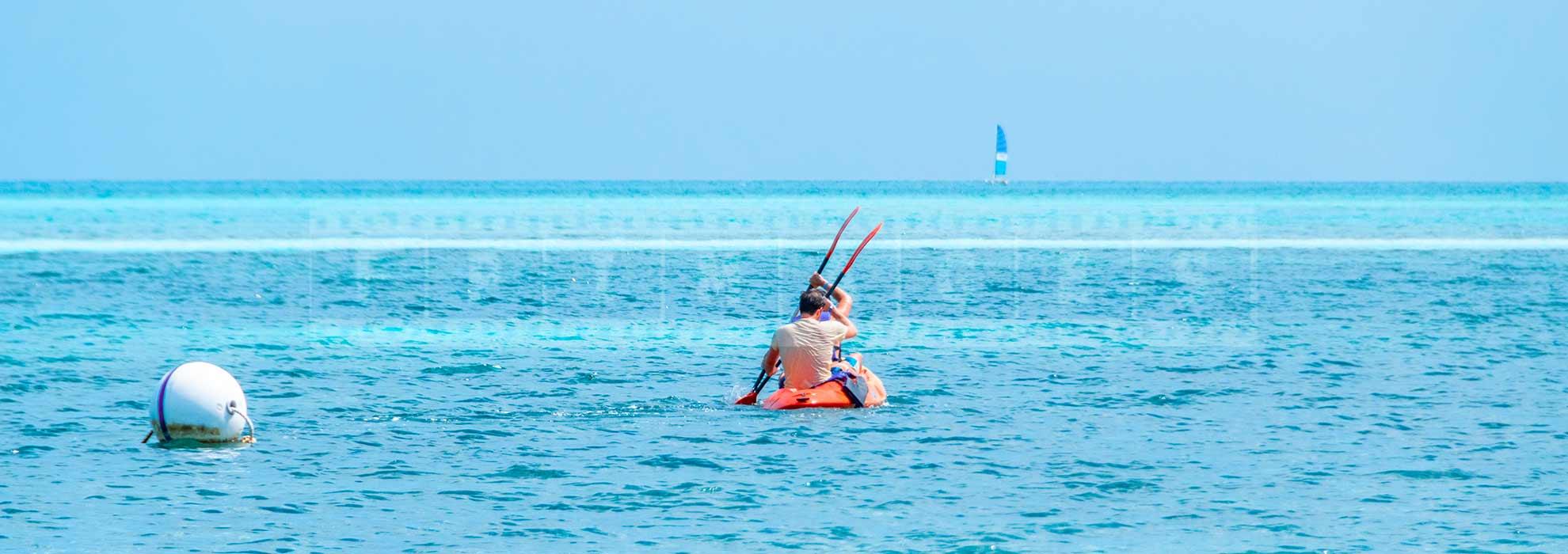 People enjoying kayak at Iberostar Daiquiri beach cuba