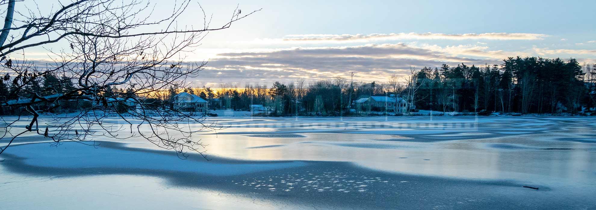 Winter scene - sunrise above frozen lake in Sackville, NS, Canada