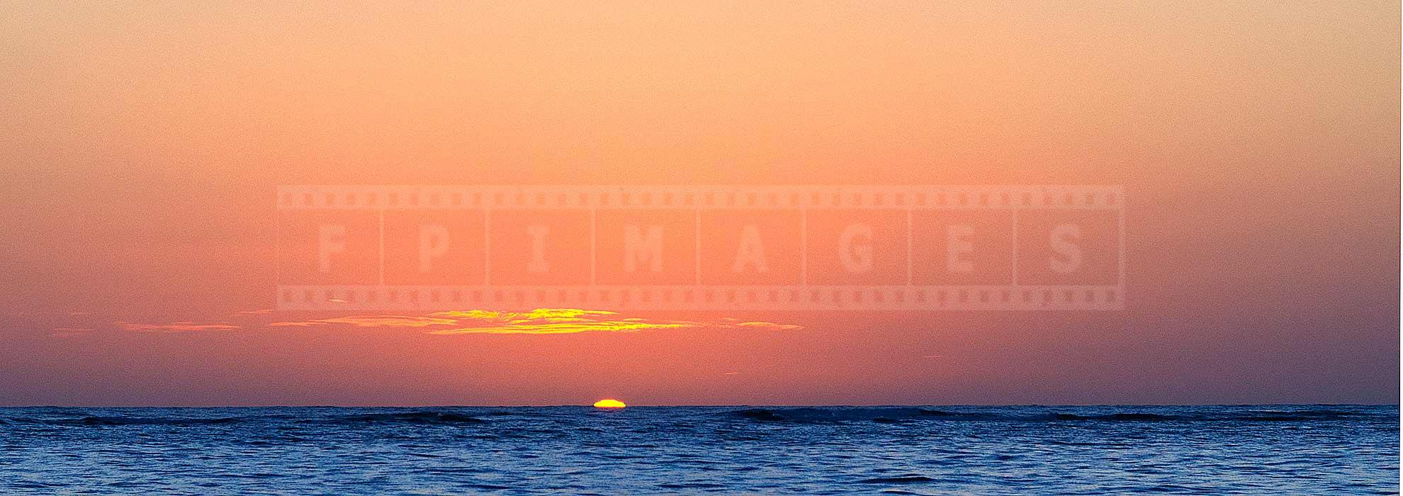 sun rising above the ocean in punta cana