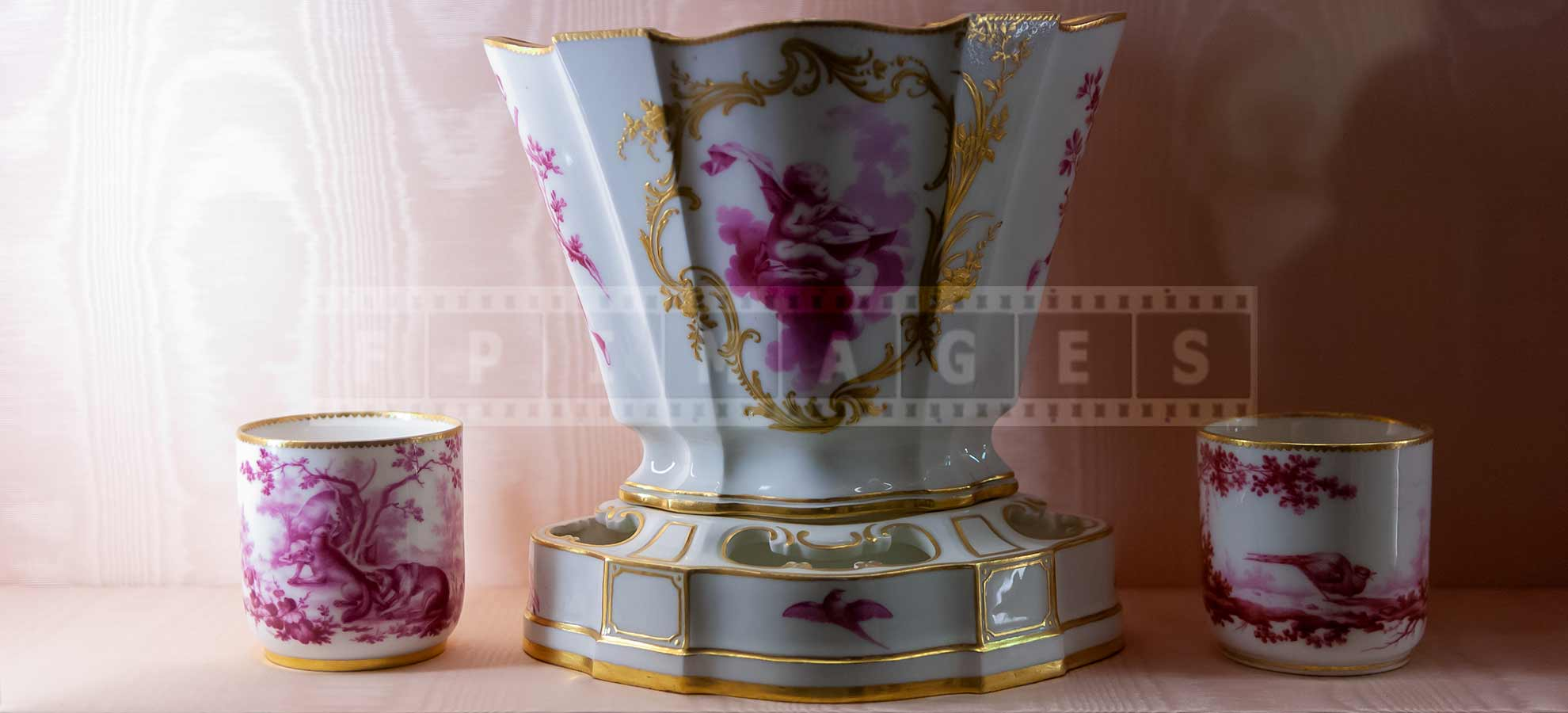Porcelain cups and a vase with golden accents