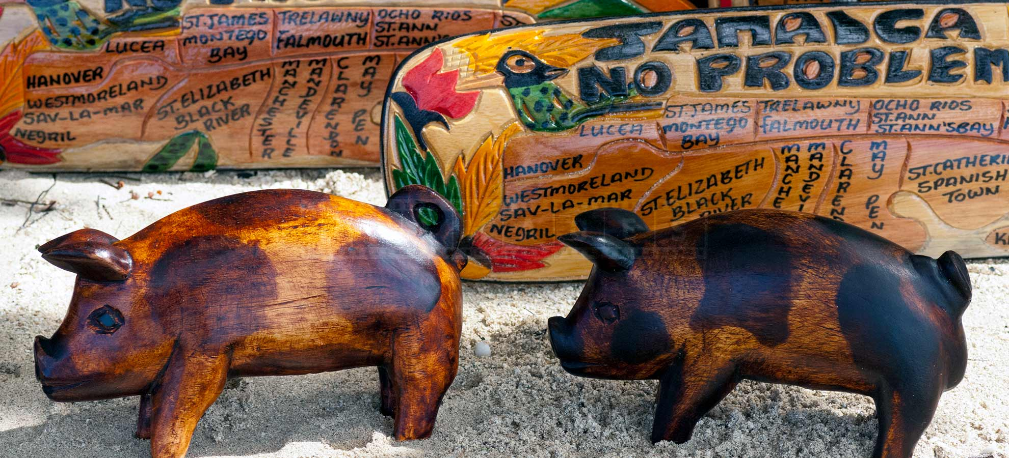 beachfront market with jamaican wood carvings