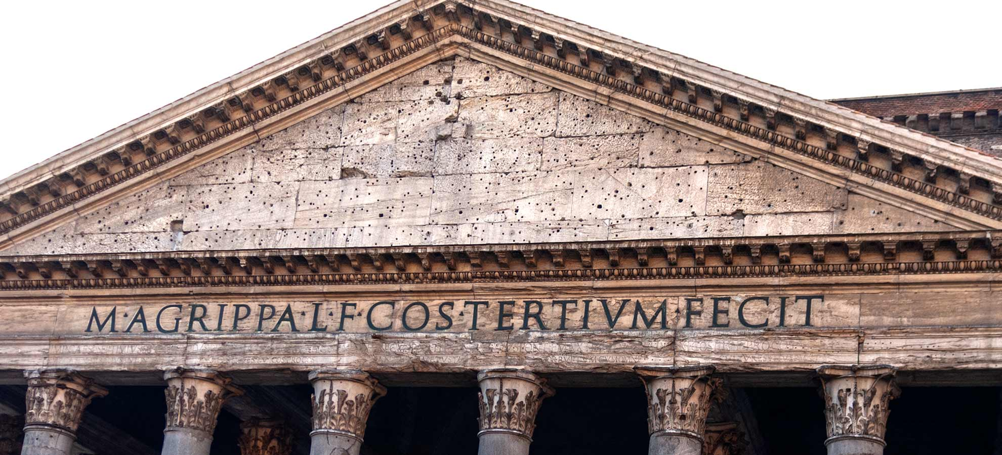 Front of the Pantheon's Portico with a sign saying Marcus Agrippa built this